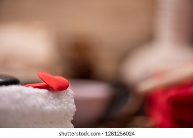Wellness docoration on valentine's day with candels and stones close up
