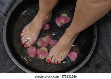 wellness foot bath with rose petals