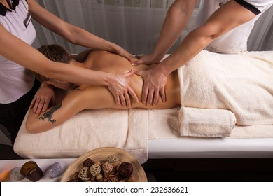 wellness massage in the spa salon make four hands