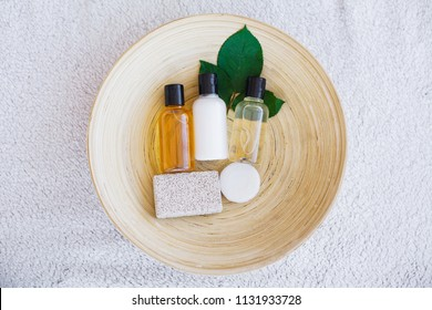 Wellness Products and Cosmetics. Herbal and mineral skincare. Jar of cream, white cosmetic bottles. Without label. Spa Set with soap and white towel.