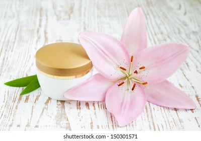 Wellness and spa scene with lily and beauty cream