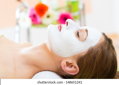 Wellness - woman receiving facial mask in spa for clean and moist skin