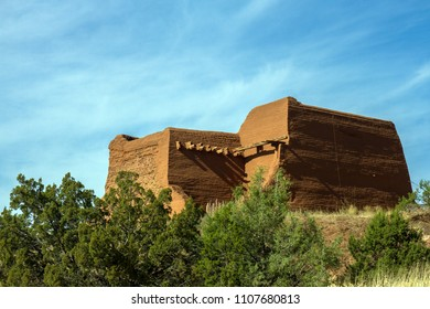 Well-preserved walls of a Spanish mission church built in 1717 in Pecos, New Mexico, showing native juniper trees