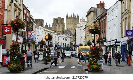 WELLS - AUG 30: Street view of shoppers in the city centre on Aug 30, 2013 in Wells, UK. The historic Somerset city of Wells is described as the UK's smallest city with a popular of around 11,500.
