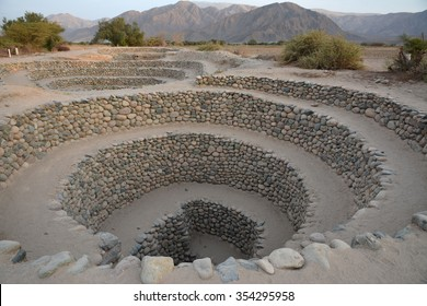 Wells constructions and part of elaborate underground aqueduct system made by the people of Nazca at 400/500 AD, Nazca Desert in southern Peru.