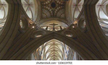 Wells, England - June 2, 2018: Interior of Wells Cathedral - Central Tower, looking up Scissor Arches
