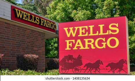 Wells Fargo sign and stagecoach logo near bank branch - Sunnyvale, California, USA - May 25, 2019