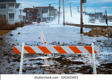 Wells, Maine, USA: March 3, 2018: Storm waves crash over the seawall causing massive flooding, power outages, road closures, and erosion damage along the Maine coast.