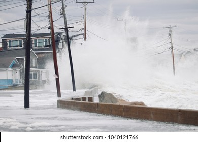 Wells, Maine, USA: March 4, 2018: Nor'easter storm sends massive waves crashing over the sea wall and houses in Wells, Maine.  The storm causes massive flooding and property damage.
