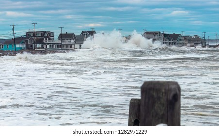 Wells, Maine, USA: March 4th, 2018: Nor'easter storm waves crash over the seawall and flood beach houses along the coast in Wells, Maine.