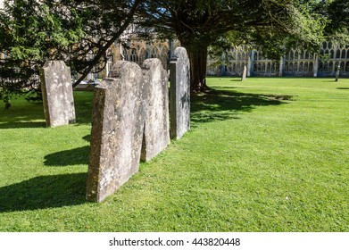 Wells, UK - August 15, 2015: Churchyard and cloister in the Cathedral of Wells. Wells is a Cathedral City in Somerset.