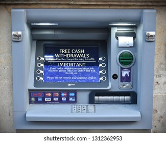Wells, UK - August 25, 2017: An ATM or Automated Teller Machine is seen outside a bank on a city centre street. The UK's banks including Lloyds, HSBC, NatWest and Barclays allow free withdrawals.