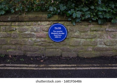 Wells, UK - March 16th 2020: A blue plaque in the city of Wells in Somerset, marking the location where famous novelist Elizabeth Goudge lived between 1903 and 1911.