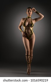 Well-shaped girl with gold tape body adornment