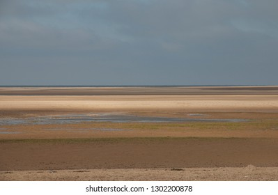 Wells-next-the-sea in north Norfolk, images of the coastline, the multi colour layers of sand on the beach, the sea, the big Norfolk skies.