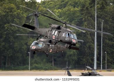 WELSCHAP, NETHERLANDS - JUN 22, 2018: United States Army Sikorsky UH-60 Blackhawk transport helicopters taking off.