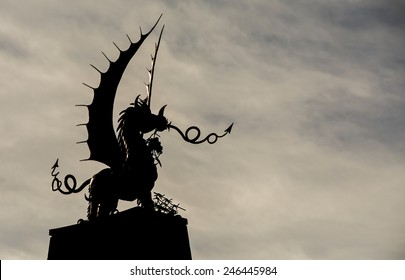 Welsh Dragon statue in Silhouette, against a wintry sky