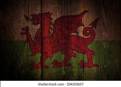 Welsh flag over a grunge wooden background.