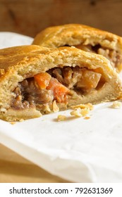 Welsh Oggie a regional delicacy from Wales of lamb leeks and vegetables baked in short crust pastry similar to a Cornish pasty