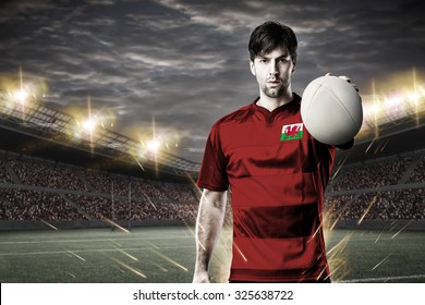 Welsh rugby player, wearing a red uniform in a stadium.