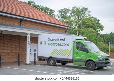 Welwyn Garden City, Hertfordshire / United Kingdom - July 7th 2019: Waitrose delivery van in it's parking space to charge the cooler in the back, ready to do delivery