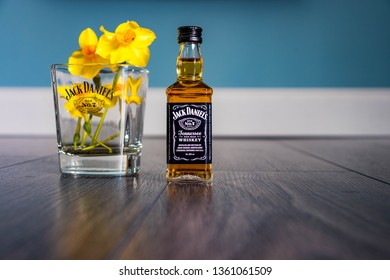 Wem, Shropshire, England - 04/01/19 : Artistic jack Daniels miniature with glass and daffodils