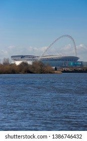 Wembly, London, England, UK - 11/28/2016: The Arch of Wembley stadium dominates the surrounding area of Wembley with Welsh Harp reservoir in foreground