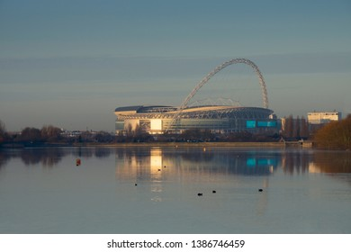 Wembly, London, England, UK - 11/28/2016: The Arch of Wembley stadium dominates the surrounding area of Wembley with Welsh Harp reservoir in foreground.