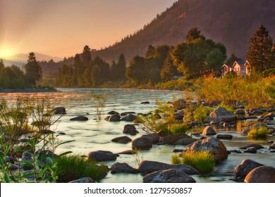 Wenatchee River sunrise during summer fires, smoke, trees, rocks,