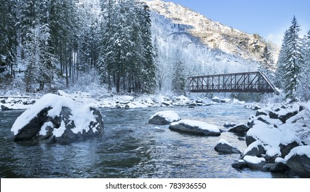 Wenatchee river in winter. Wenatchee river is a river in the state of Washington flowing from Lake Wenatchee southeast for  53 miles to Columbia River.