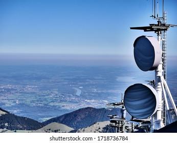 Wendelstein, Bavaria / Germany - 08 20 2019: Telecommunication antenna and satellite dishes over horizon landscape view