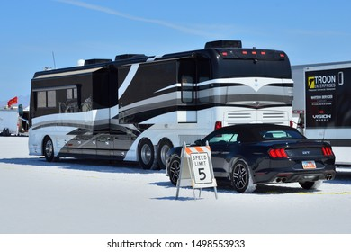 Wendover UT, USA on August 14, 2019 : Motorhome and Mustang.