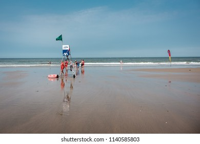 Wenduine, Belgium - 7 July 2018: Team of lifeguards at the Belgian coast.