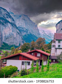 Wengen in the swiss alps surrounded by mountains in a cloudy day