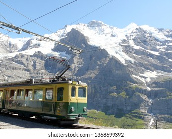 Wengen, Switzerland. 08/04/2009. Rack railway leading to the Jungfraujoch. In the background the mountain range of the Jungfrau and Monch.