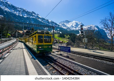 WENGEN, SWITZERLAND - MAY, 2019 : Train arriving at the Wengen train station taken on 1st May 2019. This train serves the route from Lauterbrunnen to Klein Scheidegg and back.