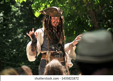 Wentzville, Missouri/USA - June 1, 2014: A Captain Jack Sparrow impersonator preforms at the St. Louis Renaissance Festival