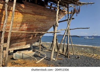 Wera Sangiang Village. Buginese Sumbawa Phinisi Boat Builder, Indonesia. These traditional schooners are generally built using hand tools and no nails...only wooden pegs.