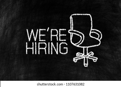We're hiring and Working Chair in Chalk Drawing Style on Old Grunge Chalkboard Background, Suitable for Jobs Concept.