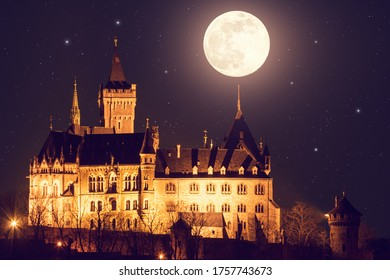 Wernigerode Castle on a full moon night with stars and lights