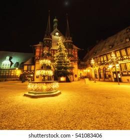 Wernigerode Christmas market with city hall and Christmas tree lights