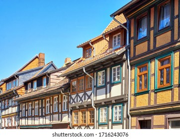 Wernigerode, Germany - April 15, 2019: Details of half-timbered houses with many small windows in the old town of Wernigerode. Saxony-Anhalt, Germany
