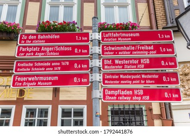 WERNIGERODE, GERMANY - JULY 04, 2020: Red tourist sign in front of a historic house in Wernigerode, Germany