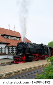 WERNIGERODE, GERMANY – MAY 23, 2020: Locomotive and carriages of the Brockenbahn in the Westerntor station in Wernigerode