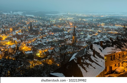 Wernigerode in winter with snow and a panoramic view of the city during dawn.