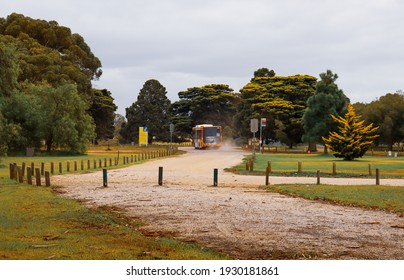 Werribee, Vic Australia - March 5 2021: Bus driving down dirt road from Werribee Park