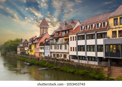 Wertheim am Main, Germany -  medieval city , old houses on the waterfront of Tauber river against the sunset -  popular tourist destination