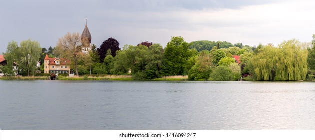 """WESSLING, BAVARIA / GERMANY - May 19, 2019: Panorama view on Lake Wessling (Weßlinger See). The lake is part of the so-called """"Fünf-Seen-Land"""" and located in the center of Wessling."""