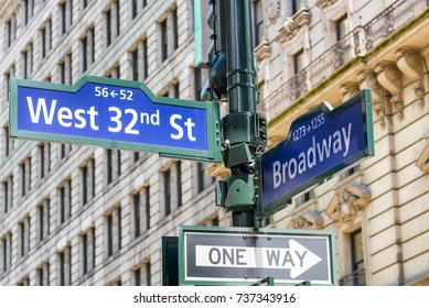 West 32 amd Broadway signs along city streets, NYC.