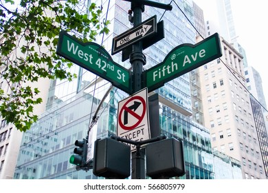 West 42nd Street, Fifth Ave, One way, No turn signs and traffic light on the pole, Manhattan, New York